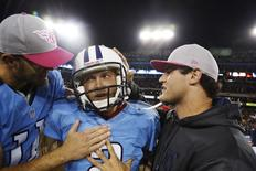 Tennessee Titans' kicker Rob Bironas (C) celebrates with Rusty Smith (L) after Bironas kicked a 40-yard field goal to lead the Titans to a win in the last seconds of their NFL football game against the Pittsburgh Steelers in Nashville, Tennessee in this October 11, 2012 file photo. REUTERS/Harrison McClary/Files