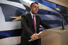 Greece's Deputy Finance Minister Christos Staikouras listens to a question during a news conference at the ministry in Athens April 30, 2014.  REUTERS/Alkis Konstantinidis