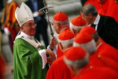 Pope Francis greets a cardinal as he leaves at the end of a mass to mark the opening of the synod on the family in Saint Peter's Square at the Vatican October 5, 2014. REUTERS/Tony Gentile
