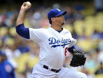 August 3, 2014; Los Angeles, CA, USA; Los Angeles Dodgers starting pitcher Josh Beckett (61) pitches the first inning against the Chicago Cubs at Dodger Stadium. Gary A. Vasquez-USA TODAY Sports