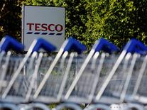 File photographs shows shopping trolleys lined up at a Tesco supermarket in London April 15, 2014.  REUTERS/Luke MacGregor/Files