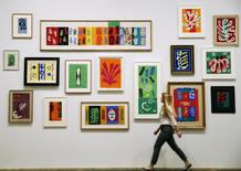 An employee poses with Henri Matisse's artworks at the Tate Modern gallery in London in this April 14, 2014 file photo.REUTERS/Luke MacGregor/Files