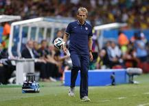 U.S. coach Juergen Klinsmann kicks the ball during the 2014 World Cup round of 16 game between Belgium and the U.S. at the Fonte Nova arena in Salvador July 1, 2014. REUTERS/Marcos Brindicci