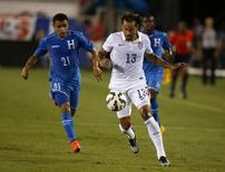 Oct 14, 2014; Boca Raton, FL, USA; USA midfielder Jermaine Jones (13) dribbles the ball as Honduras forward  Roger Rojas (21) chases the first half at FAU Stadium. Mandatory Credit: Robert Mayer-USA TODAY Sports