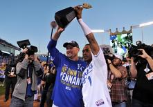 Oct 15, 2014; Kansas City, MO, USA; Kansas City Royals center fielder Jarrod Dyson (1) and designated hitter Billy Butler (left) hold up the American League championship trophy after game four of the 2014 ALCS playoff baseball game against the Baltimore Orioles at Kauffman Stadium. The Royals swept the Orioles to advance to the World Series. Mandatory Credit: Peter G. Aiken-USA TODAY Sports