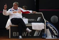 Russia' s coach Shamil Tarpischev gives instructions to his player Alexandra Panova during their Fed Cup World Group women's tennis final match against Italy's Roberta Vinci in Cagliari, November 2, 2013. REUTERS/Alessandro Bianchi