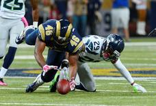 Oct 19, 2014; St. Louis, MO, USA; St. Louis Rams tight end Cory Harkey (46) and Seattle Seahawks free safety Earl Thomas (29) go after a loose ball during the second half at the Edward Jones Dome. St. Louis defeated Seattle 28-26. Mandatory Credit: Jeff Curry-USA TODAY Sports