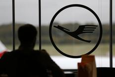 A man stands at a counter next to the logo of German airlines Lufthansa at the Cologne-Bonn airport October 20, 2014.    REUTERS/Wolfgang Rattay