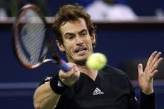 Andy Murray of Britain returns a shot during his men's singles tennis match against Teymuraz Gabashvili of Russia at the Shanghai Masters tennis tournament in Shanghai October 7, 2014. REUTERS/Aly Song