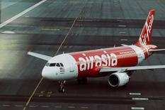 An AirAsia plane is seen on the runway at Kuala Lumpur International Airport August 19, 2014. . REUTERS/Olivia Harris