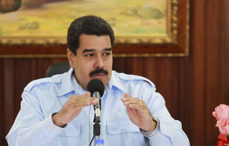 Venezuela's President Nicolas Maduro speaks during a meeting at Miraflores Palace in Caracas in this handout photo provided by the Miraflores Palace October 22, 2014.    REUTERS/Miraflores Palace/Handout via Reuters