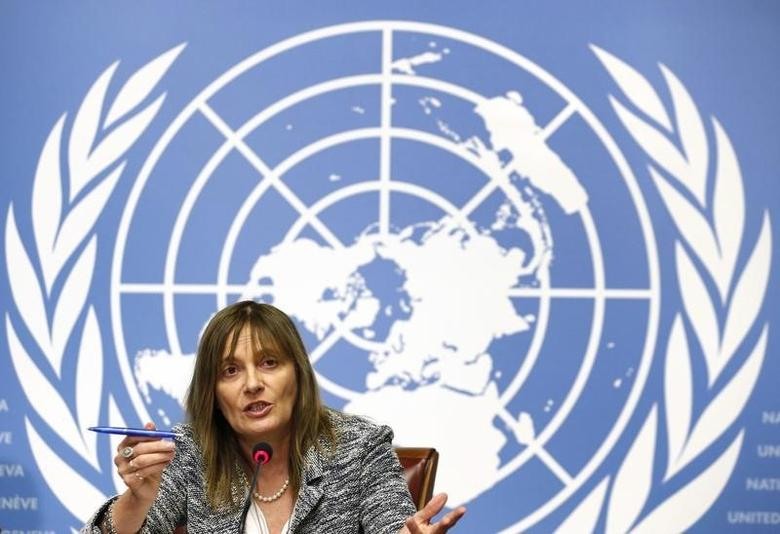 Marie Paule Kieny, World Health Organization (WHO) assistant Director General for Health Systems and Innovation gestures during a news conference on Ebola candidate vaccines, at the United Nations European headquarters in Geneva October 21, 2014.     REUTERS/Denis Balibouse