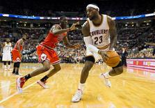 Oct 20, 2014; Columbus, OH, USA; Cleveland Cavaliers forward LeBron James (23) spins past Chicago Bulls forward Tony Snell (20) at Value City Arena. Cleveland won the game 107-98. Mandatory Credit: Greg Bartram-USA TODAY Sports
