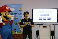 """Super Mario Bros"" creator Shigeru Miyamoto together with Nintendo character Mario (L) seen during a news conference at the 2014 Electronic Entertainment Expo, known as E3, in Los Angeles, California June 11, 2014.  REUTERS/Kevork Djansezian/Files"