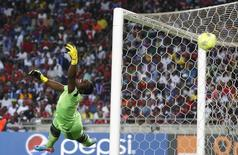 Goalkeeper Senzo Meyiwa of South Africa's Orlando Pirates is beaten by a goal made by Mohamed Aboutrika of Egypt's Al Ahli during the first leg of their African Champions League final soccer match at Orlando Stadium in Soweto November 2, 2013. REUTERS/Siphiwe Sibeko/Files
