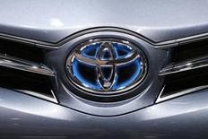 A Toyota logo is seen on a car displayed on media day at the Paris Mondial de l'Automobile, October 2, 2014.  REUTERS/Benoit Tessier