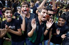 Gay rights activists shout slogans during a protest against a verdict by the Supreme Court to reinstate a ban on gay sex, in Mumbai in this December 15, 2013 file photo. REUTERS/Danish Siddiqui/Files