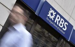 A man walks past a branch of The Royal Bank of Scotland (RBS) in central London August 27, 2014. REUTERS/Toby Melville