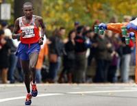 Geoffrey Mutai of Kenya runs in the New York City Marathon in New York, November 3, 2013. REUTERS/Adam Hunger