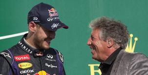 Red Bull Formula One driver Sebastian Vettel of Germany (L) talks to racing legend Mario Andretti after winning the U.S. F1 Grand Prix final at the Circuit of the Americas in Austin, Texas November 17, 2013.    REUTERS/Adrees Latif