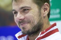 Stanislas Wawrinka smiles during a news conference at Palexpo in Geneva September 9, 2014.  REUTERS/Denis Balibouse/Files