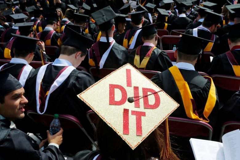A graduating student has ''I Did It'' written on her mortar board during Commencement Exercises at Boston College, May 19, 2014.    REUTERS/Brian Snyder