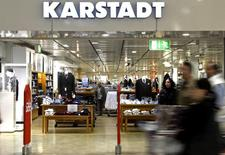 People pass an entrance of a Karstadt department store in Hamburg-Billstedt October 24, 2014. REUTERS/Fabian Bimmer