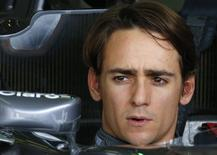 Sauber Formula One driver Esteban Gutierrez of Mexico sits in his car during a practice session at the Belgian F1 Grand Prix in Spa-Francorchamps August 22, 2014. REUTERS/Yves Herman