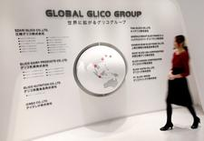 An employee of Ezaki Glico walks past a map displaying the companies in the Global Glico Group at Glicopia East, a museum of the company located next to its Kitamoto factory, in Kitamoto, north of Tokyo October 16, 2014. REUTERS/Issei Kato