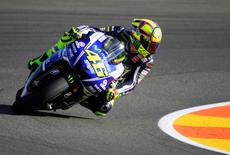 Yamaha MotoGP rider Valentino Rossi of Italy looks back as he races during the first free practice session ahead of the Valencia Motorcycle Grand Prix at the Ricardo Tormo racetrack in Cheste, near Valencia, November 7, 2014. REUTERS/Heino Kalis