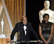 Honoree singer and social activist Harry Belafonte speaks after receiving the Oscar statuette for the Jean Hersholt Humanitarian Award, at the Academy of Motion Picture Arts and Sciences Governors Awards in Los Angeles, California November 8, 2014.  REUTERS/Kevork Djansezian