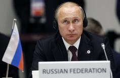 Президент РФ Владимир Путин на саммите Азия-Европа в Милане 17 октября 2014 года. Россия не будет вводить ограничения на движение капитала, сказал президент РФ Владимир Путин, выступая на саммите Азиатско-Тихоокеанского экономического сотрудничества в Пекине. REUTERS/Alessandro Garofalo