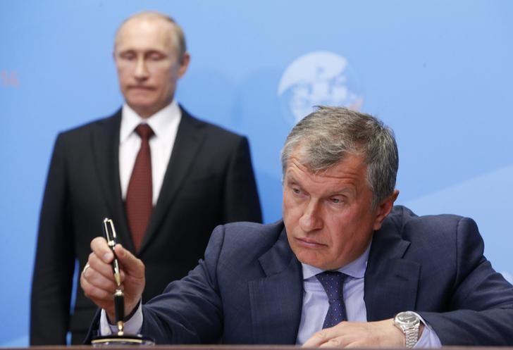 Image result for Rosneft CEO Igor Sechin with Vladimir Putin at a signing ceremony at the St. Petersburg International Economic Forum 2014. (Photo: Sergei Karpukhin/Reuters)