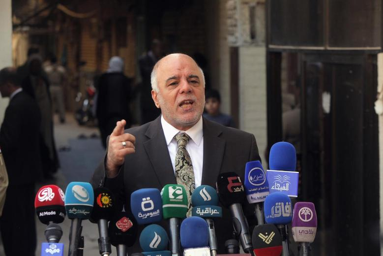Iraqi Prime Minister Haider al-Abadi speaks at a news conference during his visit to Najaf, south of Baghdad, October 20, 2014.  REUTERS/Alaa Al-Marjani