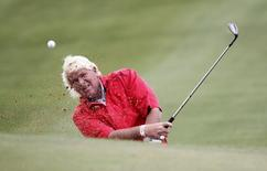 John Daly of the U.S. hits out of a sand trap on the second hole during the BMW Masters 2013 golf tournament at Lake Malaren Golf Club in Shanghai October 25, 2013. REUTERS/Carlos Barria