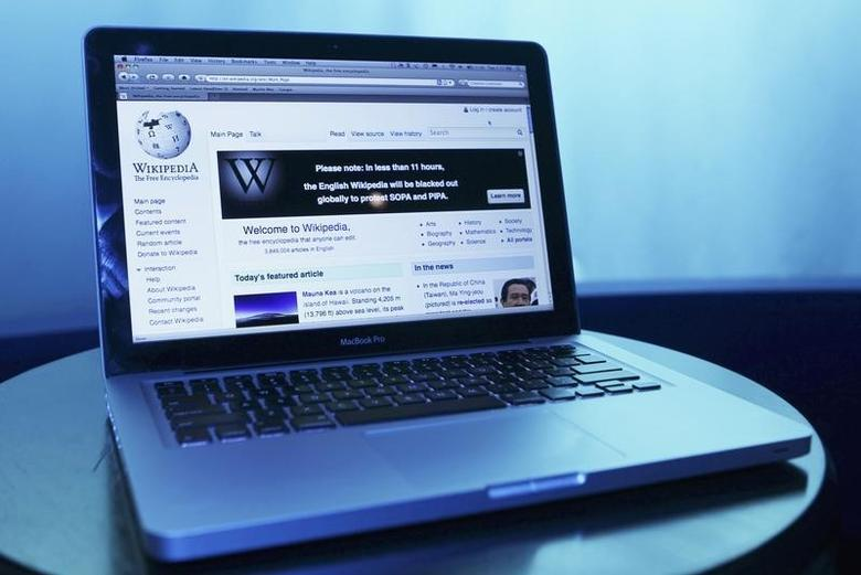 Wikipedia webpage in use on a laptop computer is seen in this photo illustration taken in Washington, January 17, 2012.  REUTERS/Gary Cameron