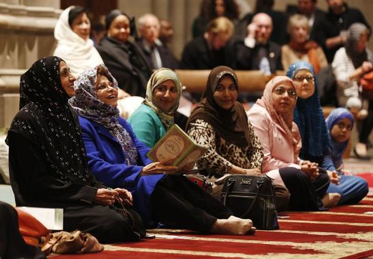 Women talk as the Washington National Cathedral and five Muslim groups hold the first celebration of Muslim Friday Prayers, Jumaa, in the Cathedral's North Transept in Washington, November 14, 2014.        REUTERS/Larry Downing
