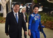 China's President Xi Jinping and his wife Peng Liyuan arrive at the Gallery of Modern Art in Brisbane as he takes part in the G20 summit November 15, 2014.  REUTERS/Peter Parks/Pool