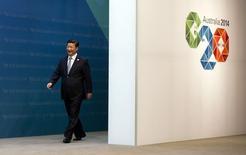 El presidente de China, Xi Jinping, llega a la cumbre del G20 en Brisbane. 15 de noviembre de 2014. REUTERS/Alain Jocard.  El presidente chino, Xi Jinping, dijo el sábado que la economía del gigante asiático mantendrá un crecimiento fuerte, sostenible y equilibrado, según declaraciones a un medio estatal.