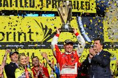 Nov 16, 2014; Homestead, FL, USA; NASCAR Sprint Cup Series driver Kevin Harvick hoists the Sprint Cup championship trophy after winning the Ford EcoBoost 400 at Homestead-Miami Speedway. Mandatory Credit: Andrew Weber-USA TODAY Sports