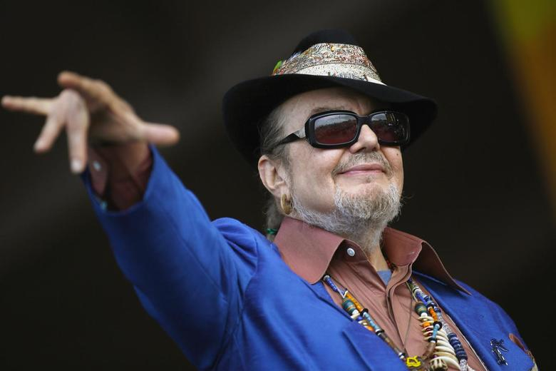 Musician Dr John gestures to the crowd during the New Orleans Jazz and Heritage Festival in New Orleans, Louisiana, in this April 26, 2013 file photo. REUTERS/Jonathan Bachman/Files