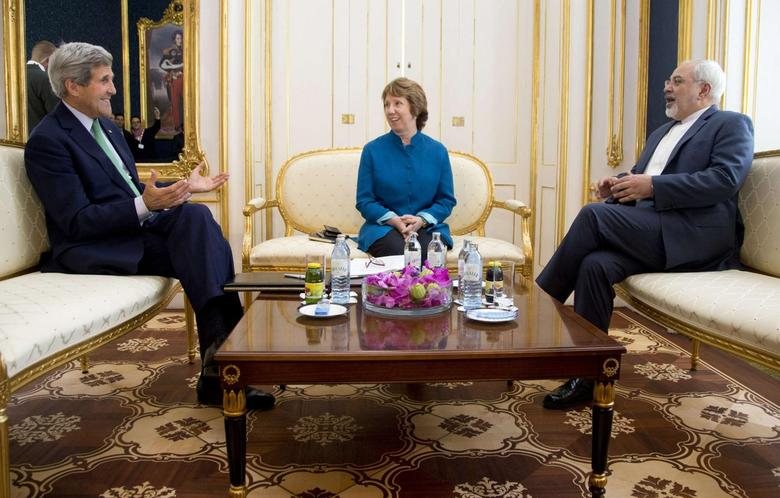 (L-R) U.S. Secretary of State John Kerry, European Union Foreign Policy Chief Catherine Ashton, and Iran's Foreign Minister Mohammad Javad Zarif are photographed as they participate in a trilateral meeting in Vienna in this October 15, 2014 file photo. REUTERS/Carolyn Kaster/Pool/Files