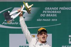 Winner Mercedes Formula One driver Nico Rosberg of Germany lifts the trophy during podium ceremony after the Brazilian Grand Prix in Sao Paulo November 9, 2014. REUTERS/Paulo Whitaker