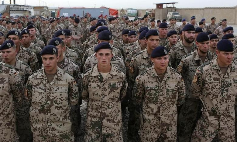 German troops who are part of the NATO-led International Security Assistance Force (ISAF), attend a memorial ceremony for slain soldiers, in the German Army's Camp Marmal in Mazar-e-Sharif, May 8, 2013.   REUTERS/Omar Sobhani