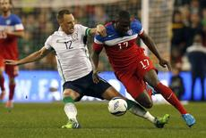 Ireland's David Meyler (L) tackles Jozy Altidore of the U.S during their international friendly soccer match at the Aviva Stadium in Dublin November 18, 2014. REUTERS/Cathal McNaughton