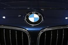 A BMW logo is seen on a car displayed on media day at the Paris Mondial de l'Automobile, October 3, 2014. The Paris auto show opens its doors to the public from October 4 to October 19. REUTERS/Benoit Tessier