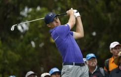 Jordan Spieth of the United States tees off on the fourth hole during the first round of the Australian Open golf tournament in Sydney, November 27, 2014.    REUTERS/Jason Reed