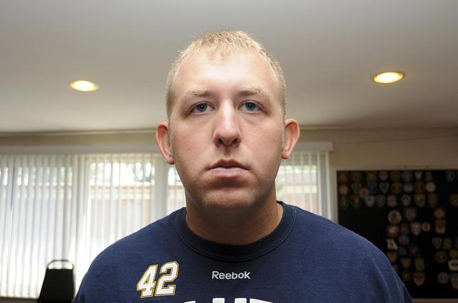 Officer Darren Wilson is pictured in this undated handout evidence photo from the August 9 Ferguson Police shooting of Michael Brown in Ferguson, Missouri, released by the St. Louis County Prosecutor's Office on November 24, 2014. REUTERS/St. Louis County Prosecutor's Office/Handout via Reuters