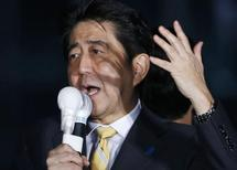 Japan's Prime Minister and leader of the ruling Liberal Democratic Party Shinzo Abe speaks ahead of a general election, in front of a Shinjuku train station in Tokyo November 28, 2014. REUTERS/Yuya Shino
