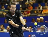 Singapore Slammers' Tomas Berdych of the Czech Republic hits a return to Manila Mavericks' Jo-Wilfried Tsonga of France during their men's singles match at the International Premier Tennis League (IPTL) in Singapore December 2, 2014. REUTERS/Edgar Su